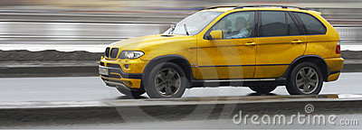 Yellow suv x5 luxury german car, driving fast