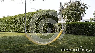 Yellow swing in village stock footage video 56773938 for Swingvillage