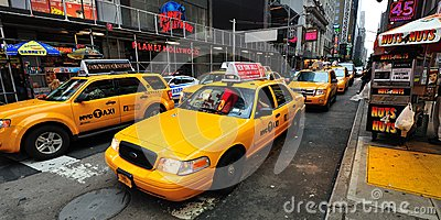 Yellow Taxicab before Times Square Editorial Photography