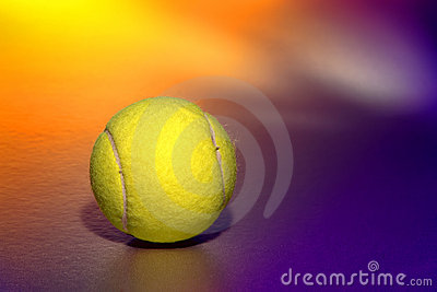 Yellow Tennis Sport Ball over Purple Background
