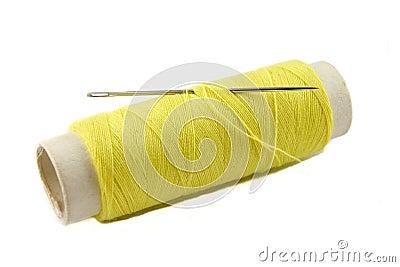 Yellow thread bobbin with needle