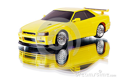 Yellow toy car and its reflection