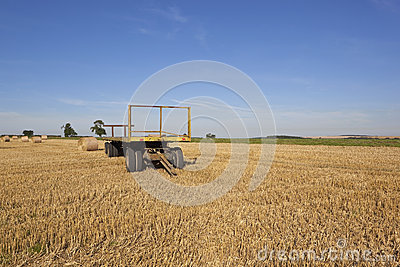 Yellow trailer in an agricultural landscape
