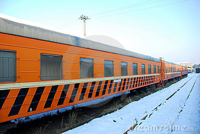 The yellow train on platform in winter
