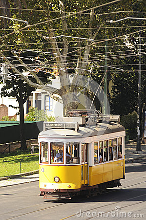 Yellow Tram on a Lisbon Street Editorial Photography