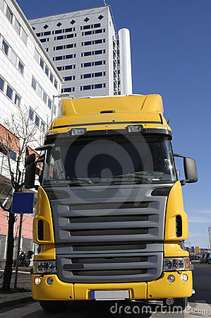 Yellow truck in business area
