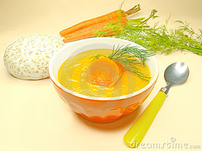 Yellow vegetable soup with carrot and bread