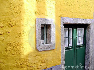 Yellow wall and green door