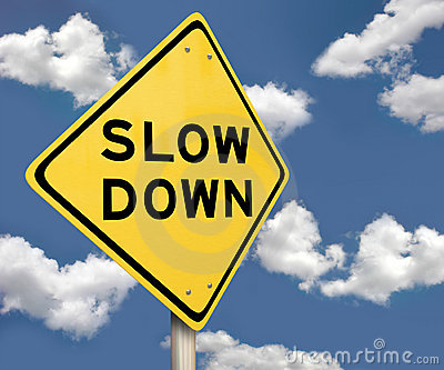 Yellow Warning Sign - Slow Down - Blue Sky
