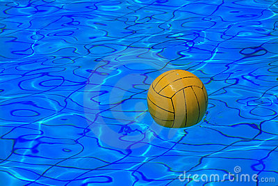 Yellow water polo ball on water background