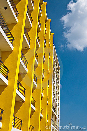 Yellow and white building and blue sky