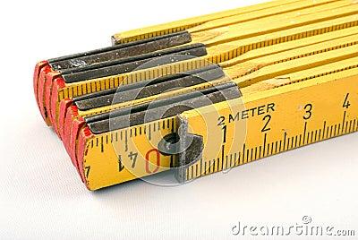 Yellow wooden meter
