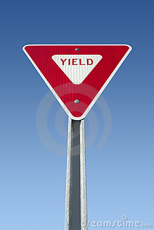 Yield sign on blue sky