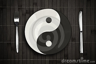 Yin yan plate over bamboo placemat concept