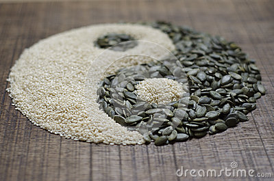 A yin yang made from seeds