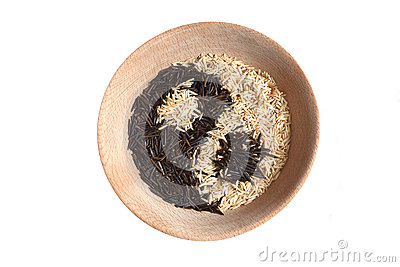 Yin and yang sign made of rice in wooden bowl.