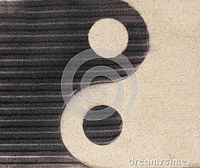 Yin-yang symbol  on the sand