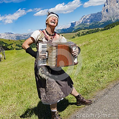 Free Yodeling In Alps - Musician Singing And Playing Accordion Royalty Free Stock Images - 108324569