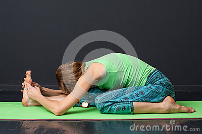 yoga ardha baddha padma paschimottanasana stock photo
