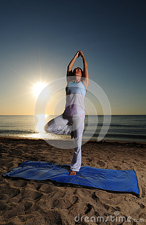 Yoga on beach with sunrise