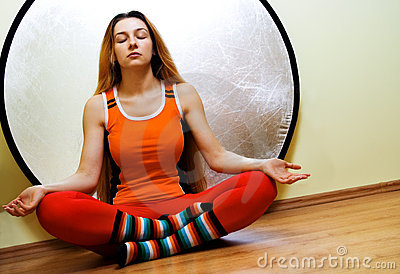 Yoga concept - woman relaxing in lotus position