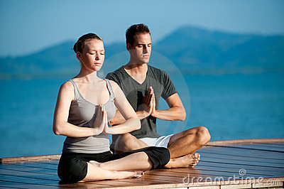 Yoga Couple By Ocean