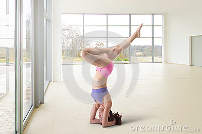 Yoga headstand in a big airy space