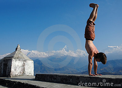 Yoga in Himalays. Handstand.
