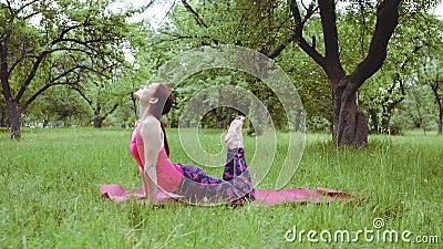 yoga instructor outdoors practicing salabhasana or locust