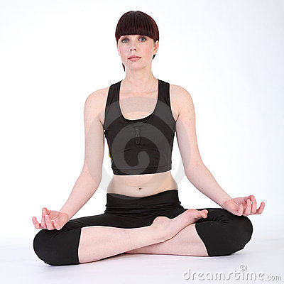 Yoga lotus pose padmasana by fit young woman