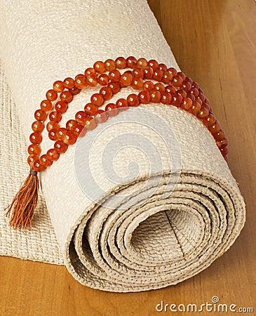 Free Yoga Mat And Rosaries Royalty Free Stock Images - 19886869