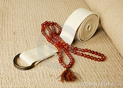 Yoga mat with rosaries and strap