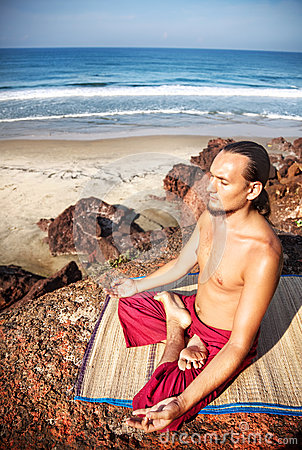 Yoga meditation on the cliff