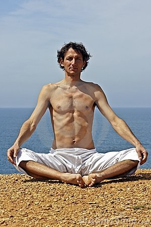 Yoga meditation on the rocks