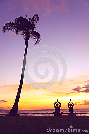 Yoga meditation - silhouettes of people at sunset