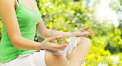 Yoga Meditation, Sitting Outdoors in Lotus Pose, Woman Meditatin Stock Photo