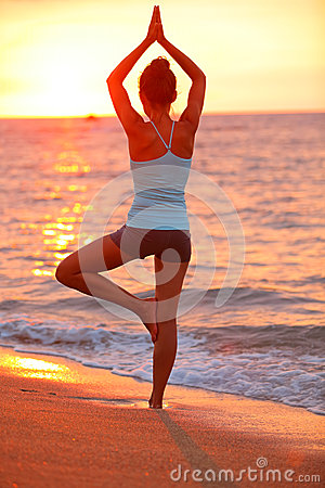 Yoga meditation woman meditating at beach sunset