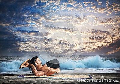 yoga nidrasana yogic sleep pose stock photos  image 24769213