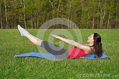 Yoga in the park. Boat pose