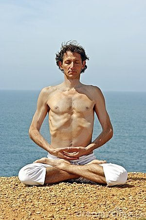 Yoga posture on the rocks