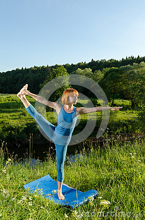 Yoga practice. Red woman practicing fitness yoga