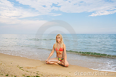 Yoga practicing at the beach