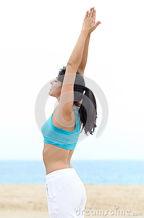 Yoga and relax woman on beach
