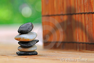Yoga Shadow by Stacked Stones in Garden
