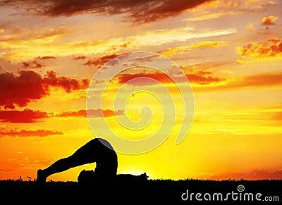 Yoga silhouette Halasana plough pose
