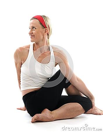 Yoga spine twisting  pose fitness trainer