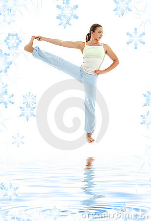 Yoga standing on white sand