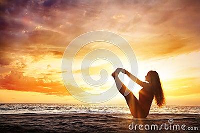Yoga at sunset beach