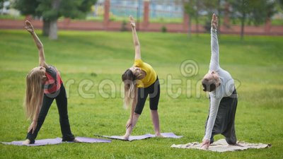 yoga training in park  young sportsmen performs