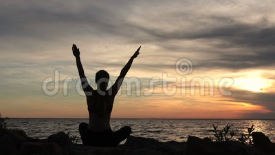 Yoga woman in lotus pose on beach at sunset stock video